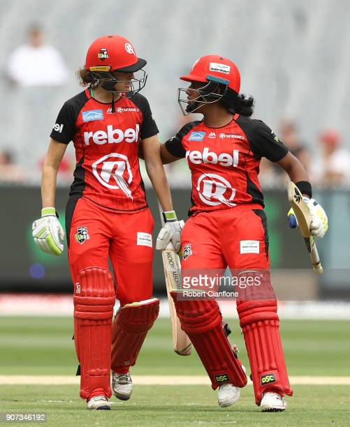 Amy Satterthwaite of the Renegades is congratulated Chamari Athapaththu after hiting a six to take the match to a super over during the Women's Big...
