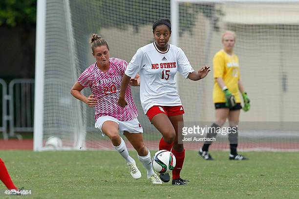Amy Schmidt of the Miami Hurricanes defends against Alyson Brown of the North Carolina State Wolfpack as she brings the ball upfield on October 11...