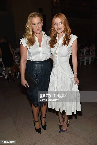 Amy Schumer and Bella Thorne attend the Zac Posen Spring 2016 fashion show during New York Fashion Week at Vanderbilt Hall at Grand Central Terminal...