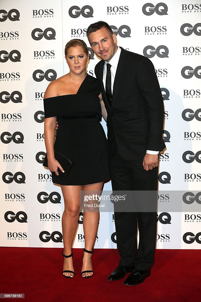 Amy Schumer and Ben Hanisch arrive for GQ Men Of The Year Awards 2016 at Tate Modern on September 6, 2016 in London, England.
