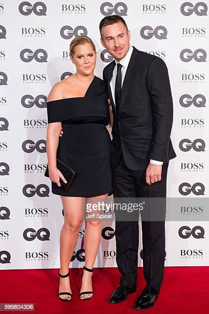 Amy Schumer and Ben Hanisch arrive for GQ Men Of The Year Awards 2016 at Tate Modern on September 6 2016 in London England