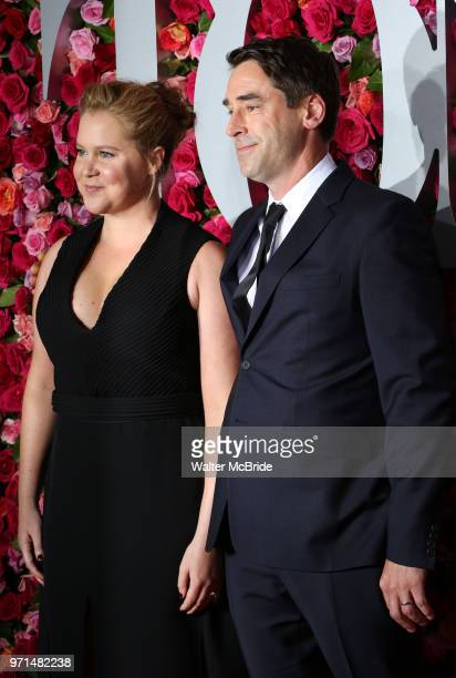 Amy Schumer and Chris Fischer attend attend the 72nd Annual Tony Awards on June 10 2018 at Radio City Music Hall in New York City