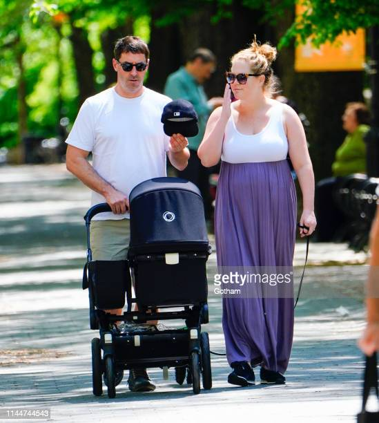 Amy Schumer and Chris Fischer take baby Gene Attell Fischer and their dog to the park on May 18 2019 in New York City
