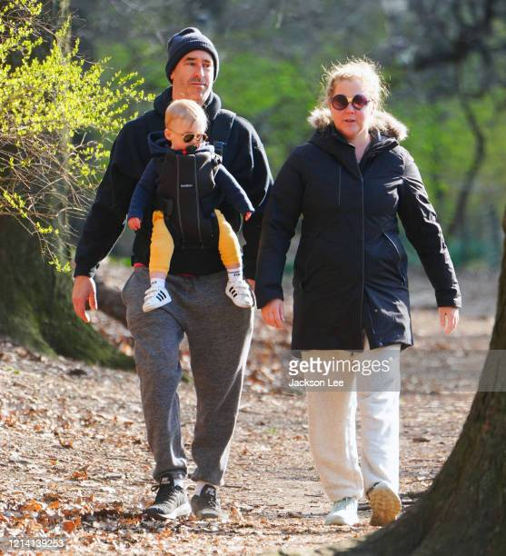 Amy Schumer and Chris Fischer take baby Gene Fischer out for some morning air on March 22, 2020 in New York City.