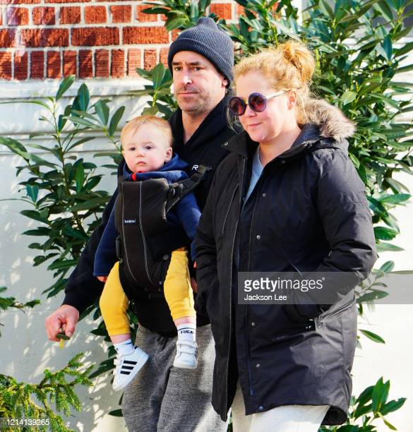 Amy Schumer and Chris Fischer take baby Gene Fischer out for some morning air on March 22 2020 in New York City
