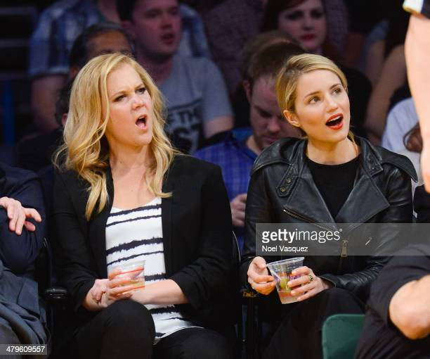Amy Schumer and Dianna Agron attend a basketball game between the San Antonio Spurs and the Los Angeles Lakers at Staples Center on March 19 2014 in...