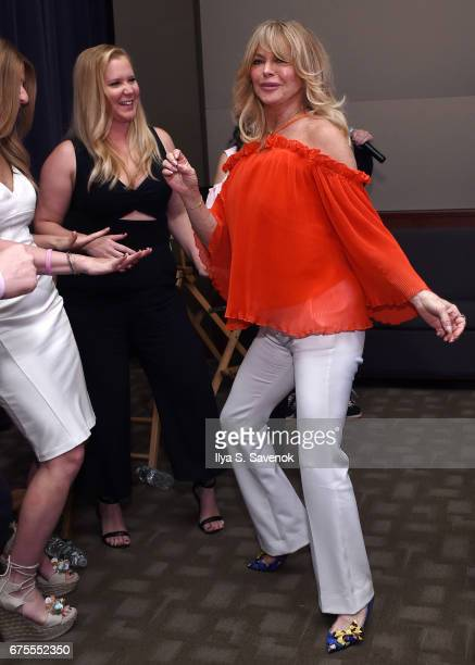 Amy Schumer and Goldie Hawn dance during The MOMS In Conversation With Amy Schumer And Goldie Hawn at Park Avenue Screening Room on May 1 2017 in New...