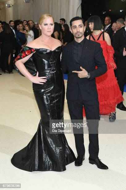 Amy Schumer and Riz Ahmed attend the 'Rei Kawakubo/Comme des Garcons Art Of The InBetween' Costume Institute Gala at Metropolitan Museum of Art on...