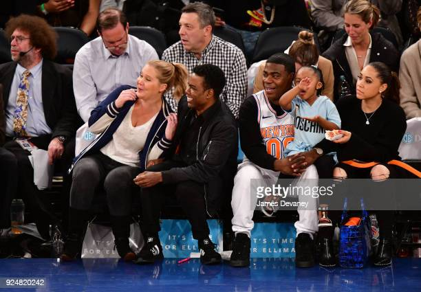 Amy Schumer Chris Rock Tracy Morgan Maven Morgan and Megan Wollover attend the New York Knicks Vs Golden State Warriors game at Madison Square Garden...