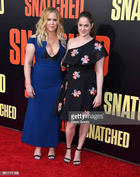 Amy Schumer Kim Caramele arrives at the Premiere Of 20th Century Fox's 'Snatched' at Regency Village Theatre on May 10 2017 in Westwood California