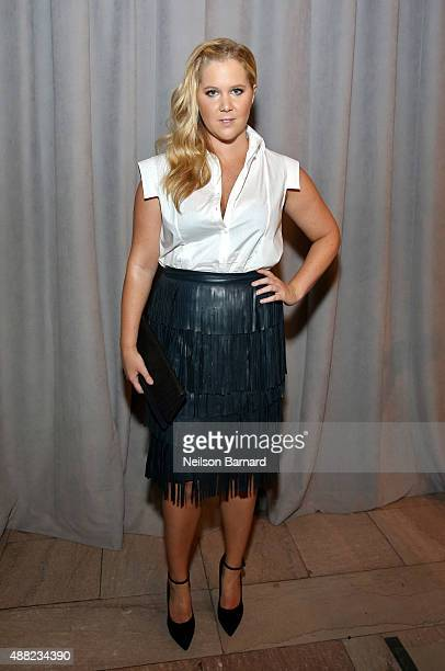 Amy Schumer poses backstage at the Zac Posen Spring 2016 fashion show during New York Fashion Week at Vanderbilt Hall at Grand Central Terminal on...