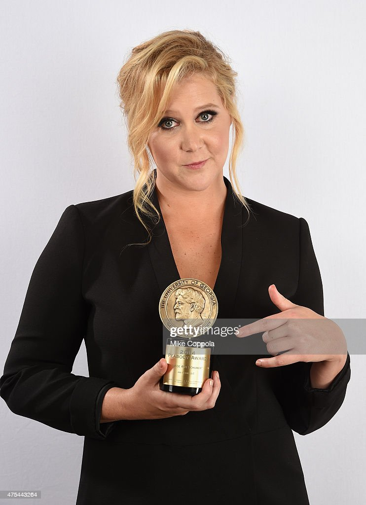 Amy Schumer poses with award during The 74th Annual Peabody Awards Ceremony at Cipriani Wall Street on May 31, 2015 in New York City.