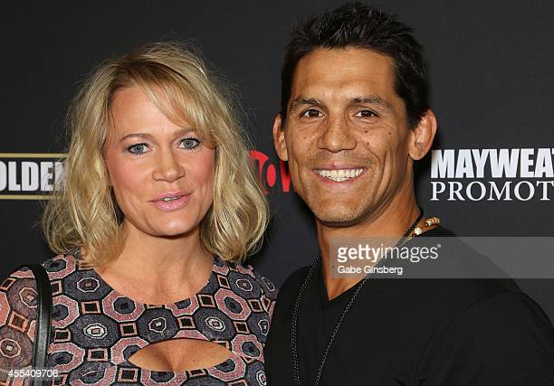 """Amy Shamrock and her husband, former mixed martial arts fighter Frank Shamrock arrive at Showtime's VIP prefight party for """"Mahem: Mayweather vs...."""