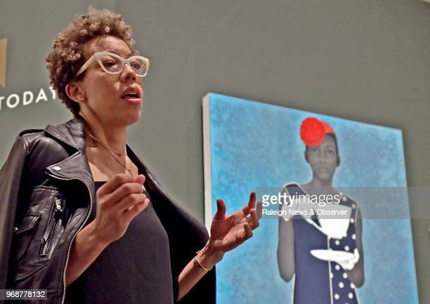 Amy Sherald speaks about painting the official commissioned portrait of Michelle Obama during a press briefing on Thursday May 31 2018 in Chapel Hill...
