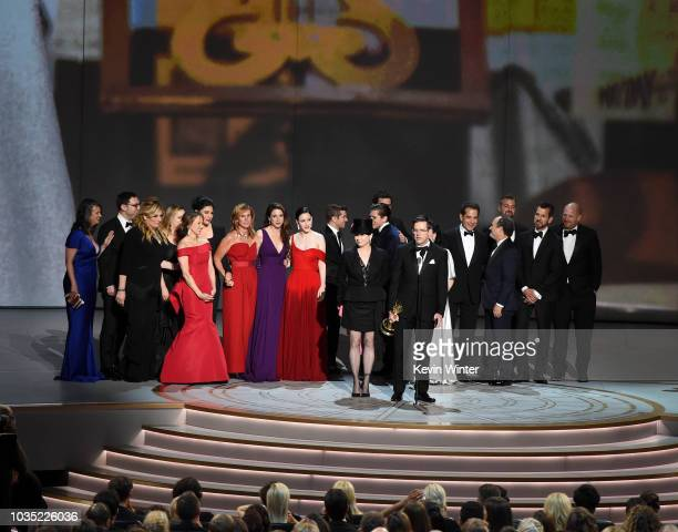 Amy Sherman-Palladino and Daniel Palladino and cast and crew accept the Outstanding Comedy Series award for 'The Marvelous Mrs. Maisel' onstage...