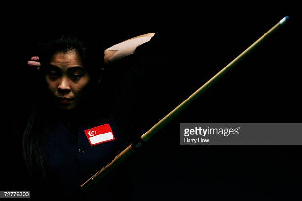 Amy Shu Wah Hoe of Singapore gets ready to play her next shot against Mary Ann Basas of Philippines in the Women's 8 Ball Pool Singles during the...