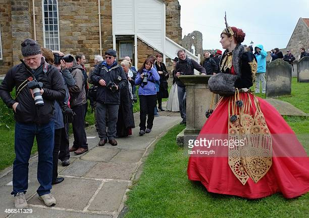 Amy Smith from Cheshire poses for photographers in the churchyard during the Goth weekend on April 26 2014 in Whitby England The Whitby Goth weekend...