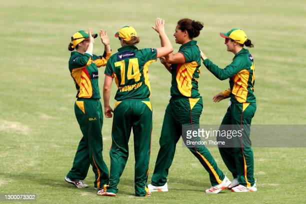 Amy Smith of the Tigers celebrates with team mates after claiming the wicket of Madeline Penna of the Meteors during the WNCL match between Tasmania...