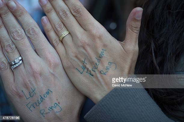Amy Snow and Christelle Snow who married in April show their wedding rings as they celebrate the Supreme Court ruling on samesex marriage on June 26...