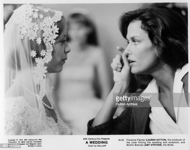 Amy Stryker listens to Lauren Hutton in a scene for the 20th Century Fox movie 'A Wedding' circa 1978