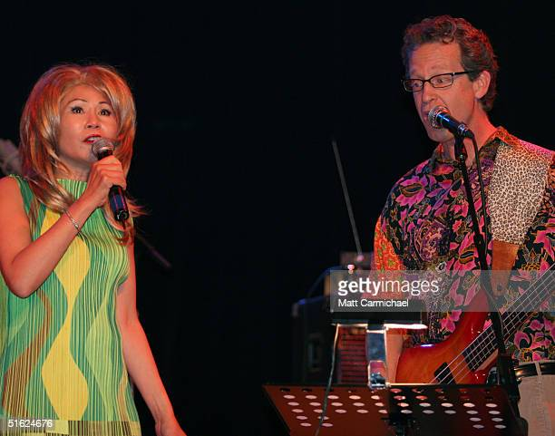 Amy Tan and Ridley Pearson perform with The Rock Bottom Remainders at Chicago's House of Blues on October 28 2004 in Chicago Illinois