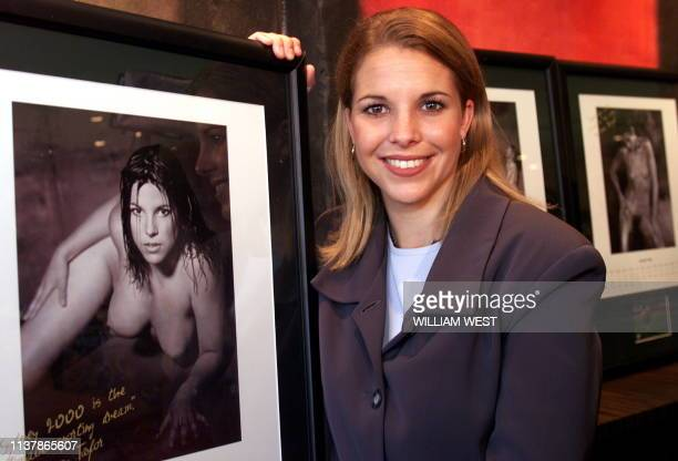Amy Taylor of the Matildas' Australia's women's soccer team poses with a nude photo of herself which is part of a calendar produced to promote...
