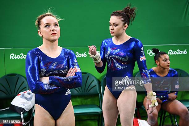 Amy Tinkler and Ruby Harrold of Great Britain look after Elissa Downie was injured and taken off during their floor apparatus during Women's...