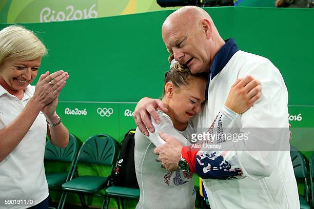 Amy Tinkler of Great Britain celebrates winning the bronze medal with her coach after competing on the Women's Floor final on Day 11 of the Rio 2016...