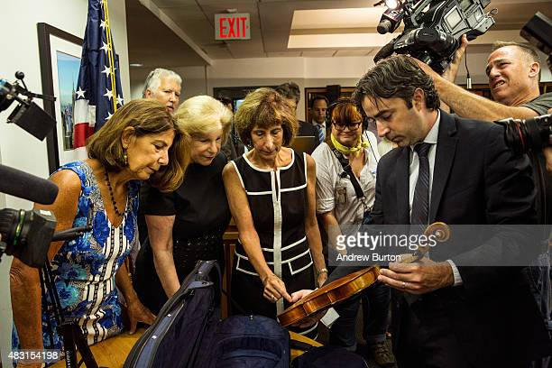 Amy Totenberg Nina Totenberg and Jill Totenberg are presented with their father's Stadivarius violin which was stolen after a concert 35 years ago by...