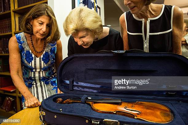 Amy Totenberg Nina Totenberg and Jill Totenberg view their father's Stadivarius violin which was stolen after a concert 35 years ago at an FBI press...