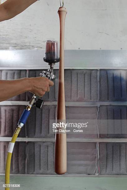 Amy Tucci spray painting a bat in the spray booth at Tucci Lumber Company which makes baseball bats Norwalk Connecticut USA 27th June 2014 Photo Tim...