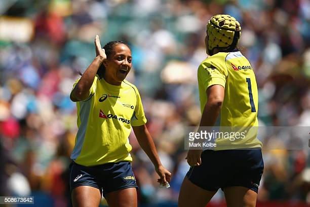 Amy Turner and Shannon Parry of Australia celebrate after a try during the 2016 Sydney Sevens women's exhibition match between Australia and Ireland...