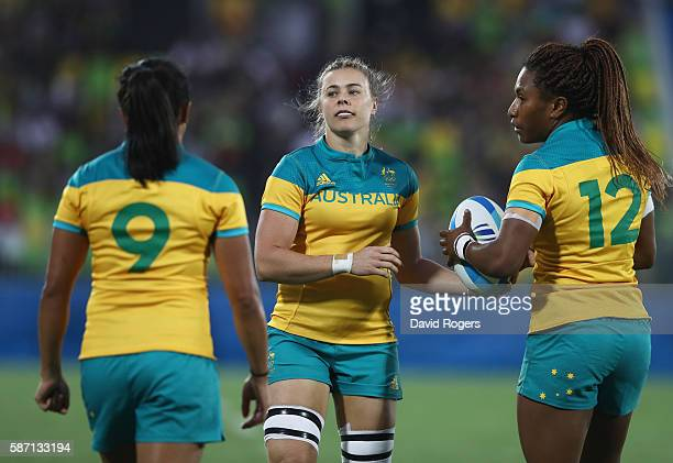 Amy Turner Nicole Beck and Ellia Green of Australia celebrate after defeating Spain in the Women's Quarterfinal rugby match on Day 2 of the Rio 2016...