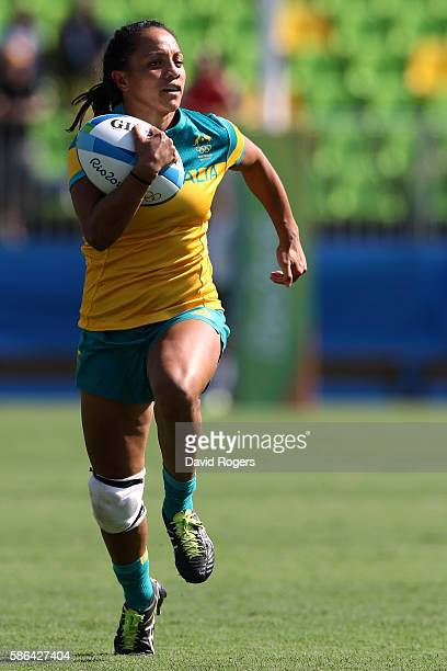 Amy Turner of Australia runs with the ball to score a try during the Women's Pool A rugby match between Ausutralia and Colombia on Day 1 of the Rio...