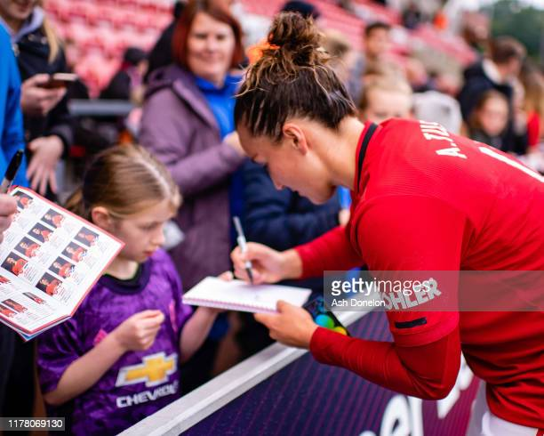 Amy Turner of Manchester United Women signs autographs for fans after the Barclays FA Women's Super League match between Manchester United and...