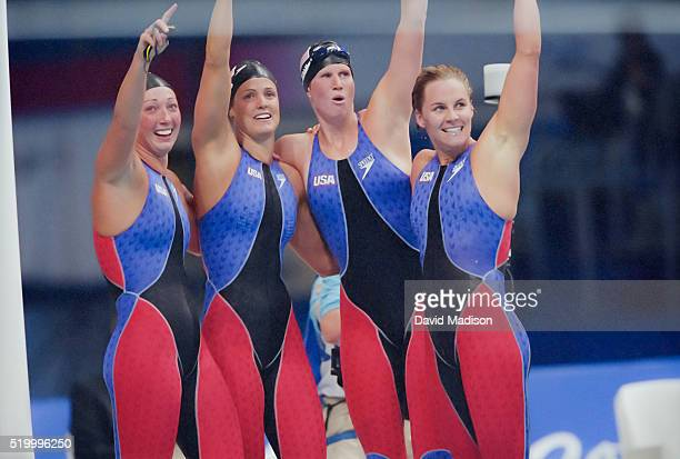 Amy Van Dyken Dara Torres Courtney Shealy and Jenny Thompson of the USA women's 4x100 meter freestyle swimming relay team celebrate their win and a...