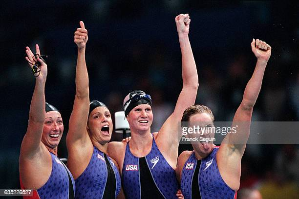 Amy van Dyken Dara Torres Courtney Shealy and Jenny Thompson of the US celebrate after winning the women's 4x100 meter freestyle relay final at the...