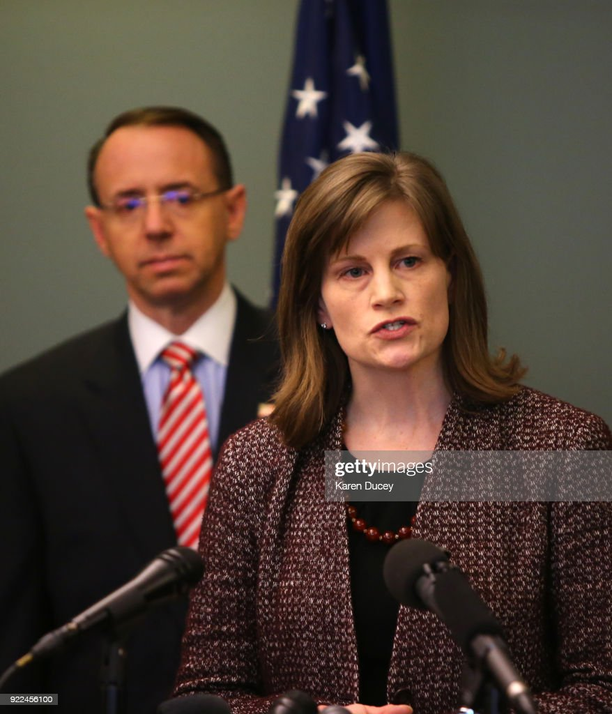 Amy Wales, daughter of Tom Wales, speaks at a press conference on the investigation into the murder of federal prosecutor Tom Wales on February 21, 2018 in Seattle, Washington. U.S. Deputy Attorney General Rod Rosenstein stands behind her.