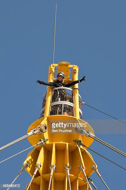Amy Willerton becomes the first celebrity to climb the pylon of the 02 Arena as she launches the DVD of 'Divergent' at 02 Arena on August 11 2014 in...