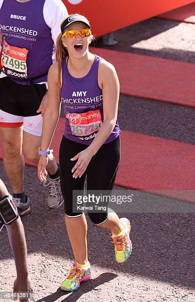 Amy Willerton crosses the finish line to complete the 2014 London Marathon on April 13 2014 in London England