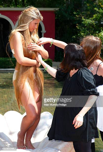 Amy Willerton recreates Botticelli's The Birth of Venus during a photocall as she attends the VIP preview day of The Chelsea Flower Show at The Royal...