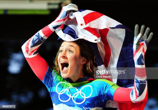 Amy Williams of Great Britain and Northern Ireland celebrates with her countries flag after she won the gold medal in the women's skeleton on day 8...