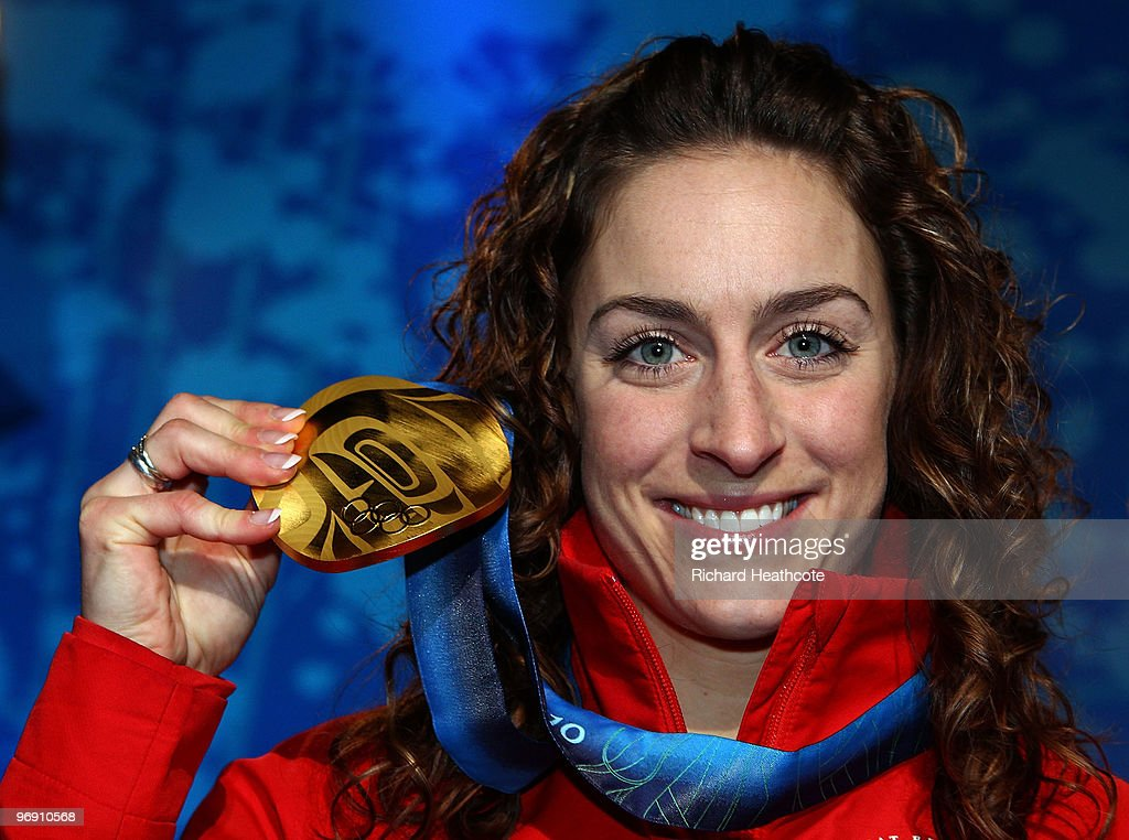 Amy Williams of Great Britain and Northern Ireland receives the gold medal during the medal ceremony for the women's skeleton held at the Whistler Medals Plaza on day 9 of the Vancouver 2010 Winter Olympics at Whistler Medals Plaza on February 20, 2010 in Whistler, Canada.