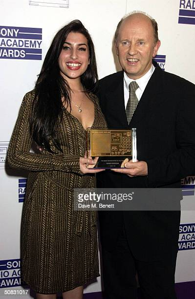 Amy Winehouse and David Rodigan pose at the Sony Radio Academy Awards at Grosvenor House Park Lane on May 12 2004 in London The prestigious awards...