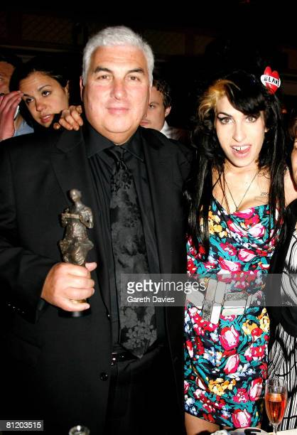 Amy Winehouse and her dad Mitch pose with her award for Best Song Musically and Lyrically for 'Love Is A Losing Game' at the 53rd Ivor Novello Awards...