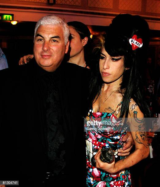 Amy Winehouse and her father Mitch pose with her award for Best Song Musically and Lyrically for 'Love Is A Losing Game' at the 53rd Ivor Novello...