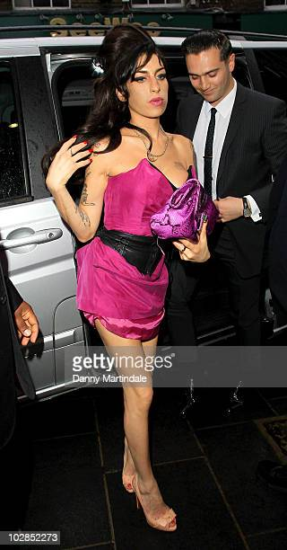 Amy Winehouse and new boyfriend Reg Traviss attend the Psychosis Premiere at the Prince Charles Cinema, Leicester Square on July 13, 2010 in London,...