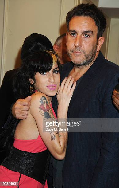 Amy Winehouse and Terry Hall attend The Q Awards at the Grosvenor House on October 26 2009 in London England