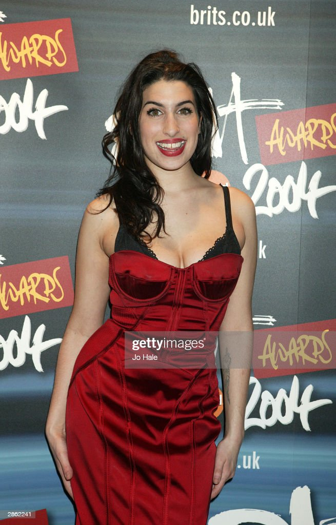 Amy Winehouse arrives at the announcement of the shortlist for The Brit Awards 2004 at the Park Lane Hotel on January 12, 2004 in London. The Brits Awards take place on February 17 2004.