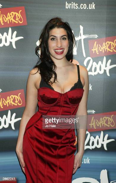Amy Winehouse arrives at the announcement of the shortlist for The Brit Awards 2004 at the Park Lane Hotel on January 12 2004 in London The Brits...